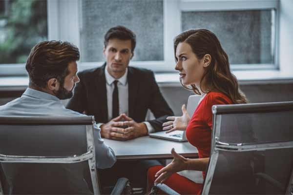 A couple meeting with a divorce mediator